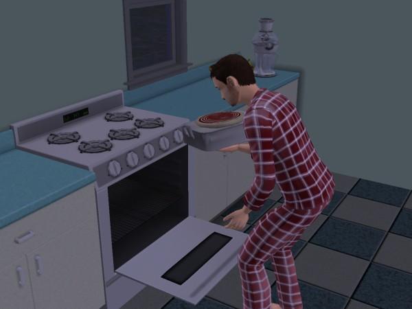 Денис готовит пицу